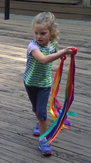 The scarves also provided a colorful gross motor experience for our youngest campers.