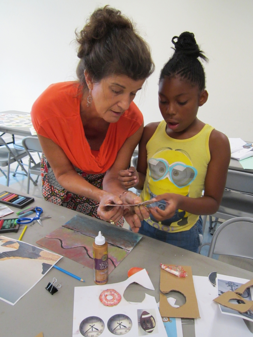 Instructor Cora Wooley Waterhouse demonstrates how to create and place a rotating 3D wheel into student projects at Campbell Park recreation center. Donut wheels were very popular!