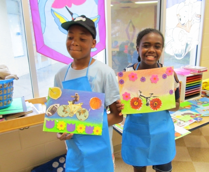 "Students at five city recreation centers  in St. Petersburg, FL were challenged to create pastel chalk or colored pencil bicycles in a surreal background featuring unusual wheels and riders.  Projects relate to our  Bicycle Safety  theme sponsored by Jeeves Law Group and  Creative Pinellas . These two students from Thomas ""Jet"" Jackson Rec. Center hold their completed collaged art."