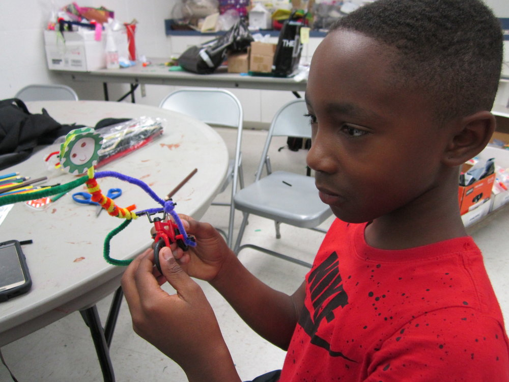 This student from Frank Pierce Rec. Center crafts his rider.