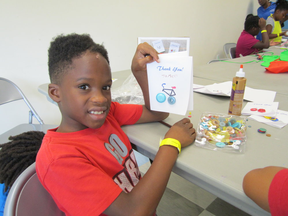 A student at Frank Pierce Rec. Center shows off his handiwork.
