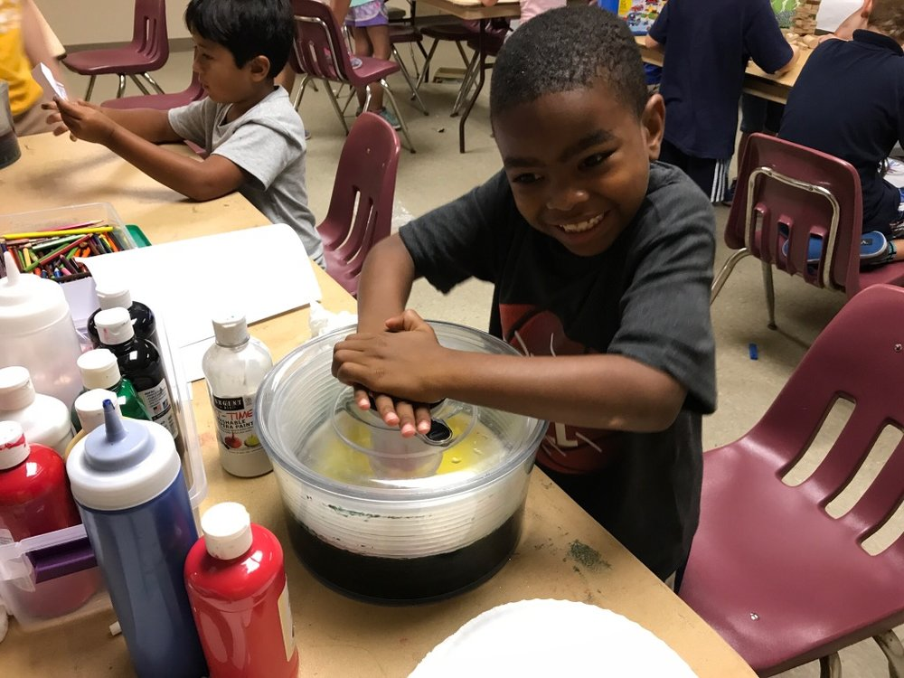 What is this camper making in that salad spinner?