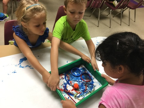 Campers worked in small groups to select objects and move them around inside their art trays, creating a truly collaborative abstract painting.
