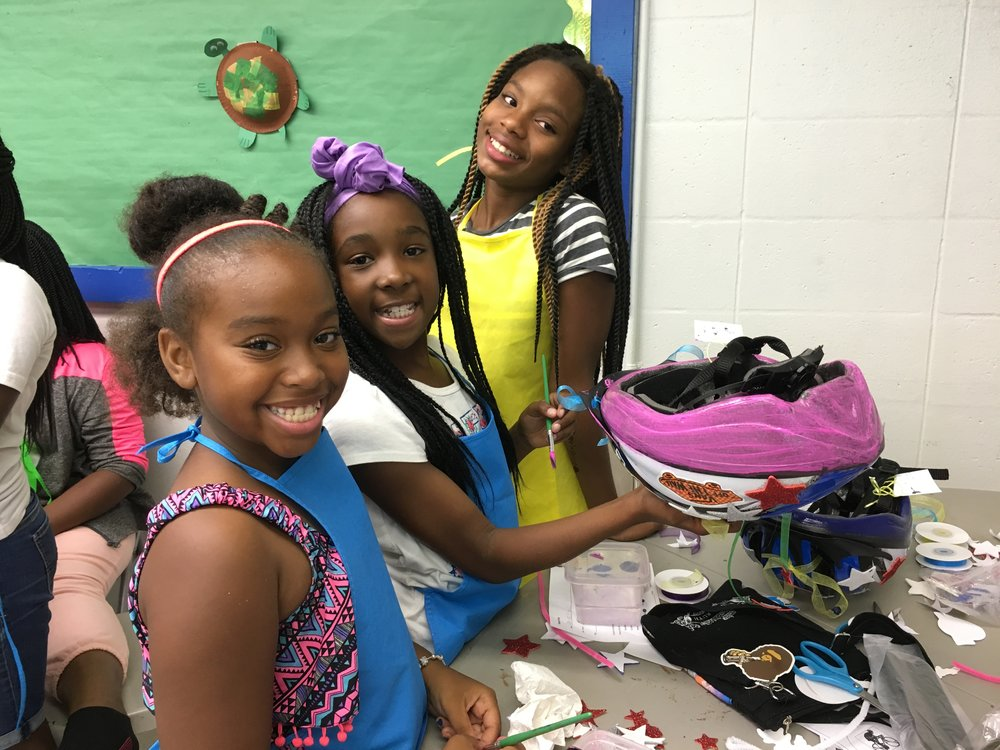 After a week's break to observe Independence Day, classes resumed on July 10 and 11 with a bang!  Students at Frank Pierce Rec. Center have fun painting and decorating their very own bicycle helmet. Helmets were donated by Jeeves Law Group.