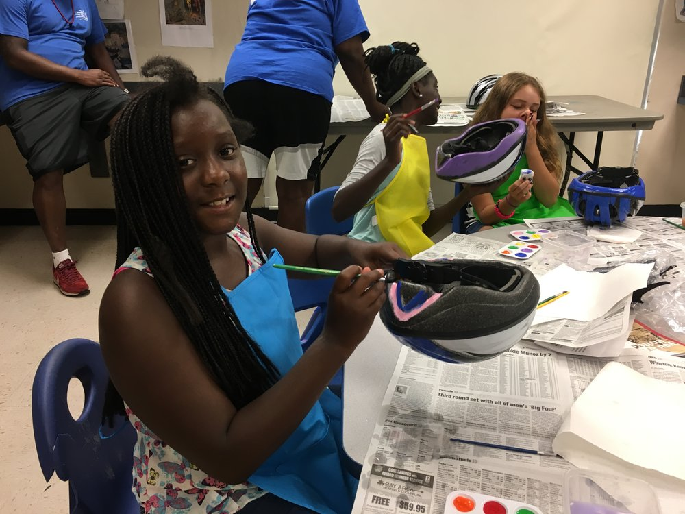 "Some students at Child's Park Rec. Center chose to paint their helmets prior to decorating the top end. Others at Thomas ""Jet"" Jackson Rec. Center decorated their helmets with wild zebra print tapes."