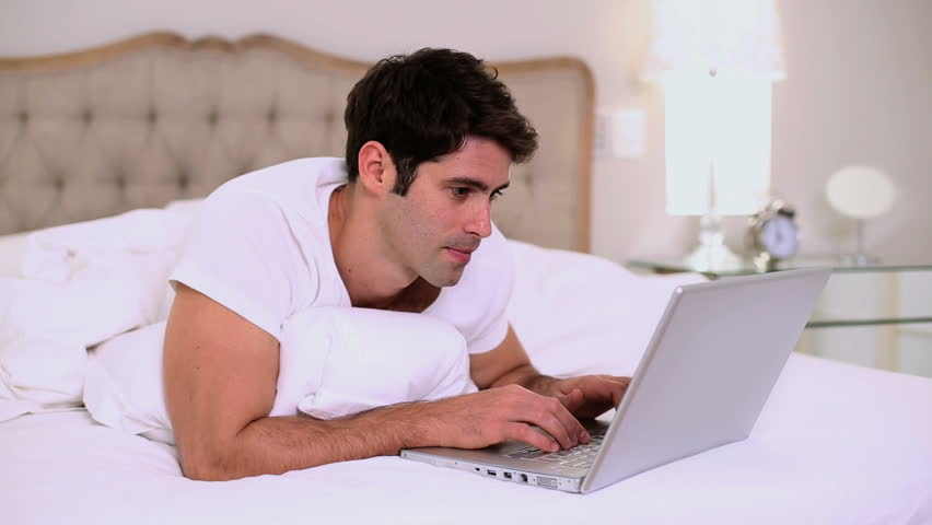 "Gotta love stock photos... Or you can pretend ""Handsome-Guy-in-bed-with-laptop"" is me"