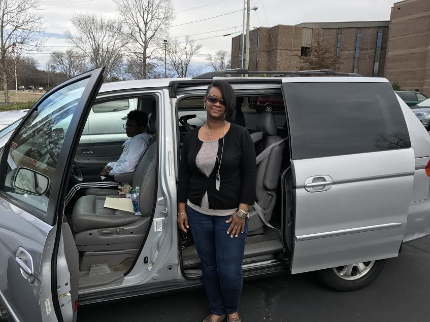 Katrina with her van.jpg
