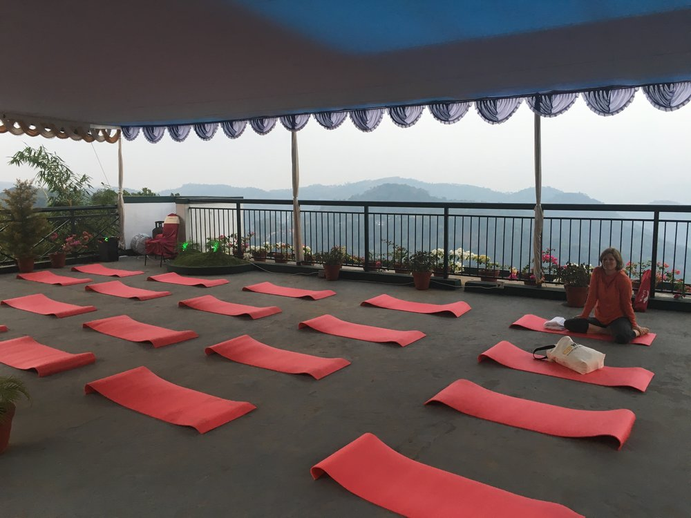 Our yoga studio on the rooftop of the hotel. Cool air, and a view of the Misty Mountains.