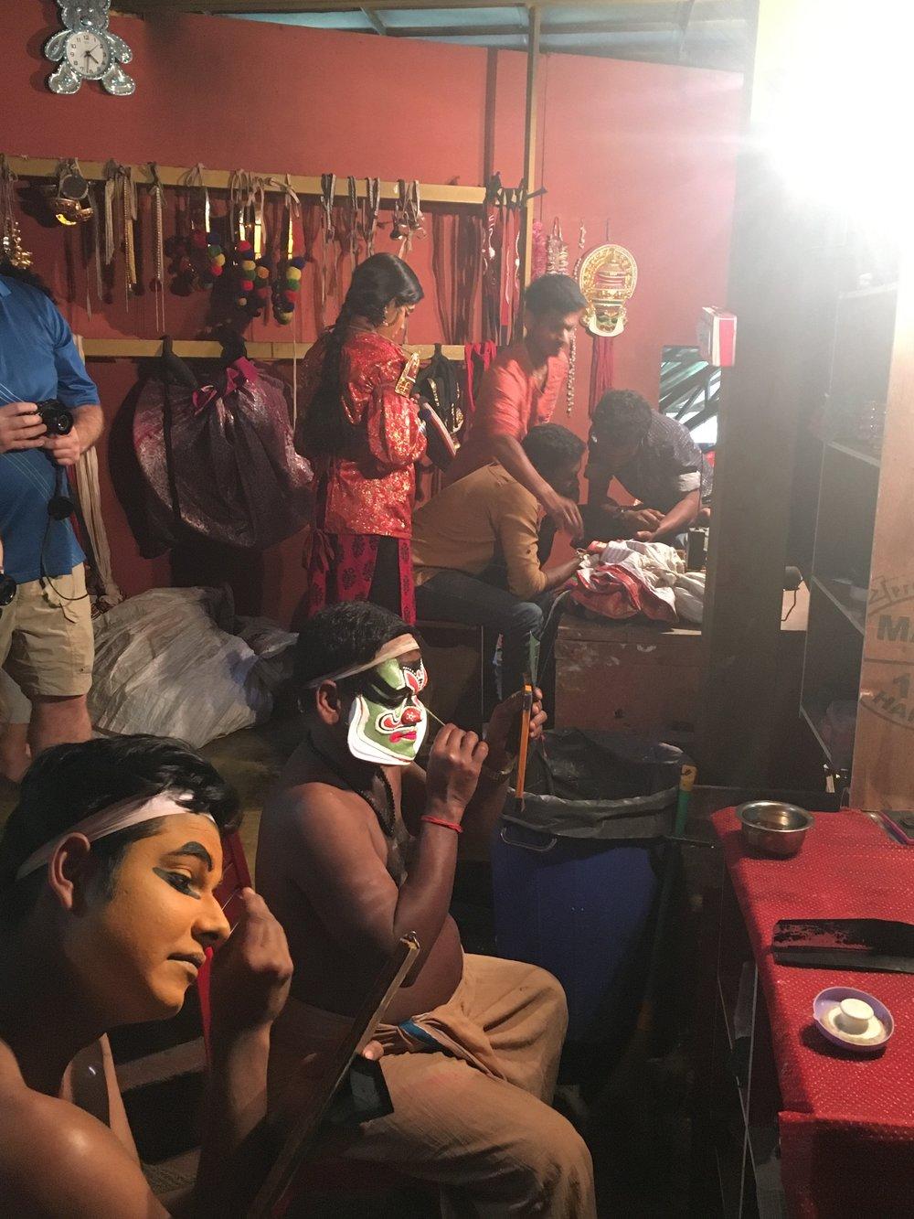 Kathakali dancers putting on their make-up