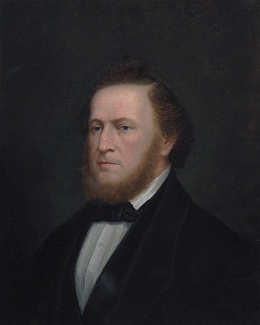 """Enoch Wood Perry, Jr. (American, 1831 – 1915) Brigham Young (1865) Oil on canvas. 27 7/8 x 21 5/8 in., 37 5/8 x 30 5/8 in., Signed """"Brigham Young by Enoch Perry"""" on reverse."""