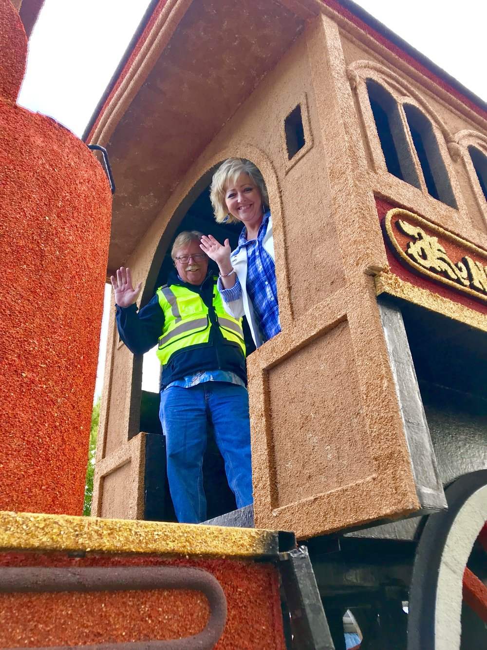 Kimberly Quarles and James Guerin made use of multiple look-out points while riding the float.