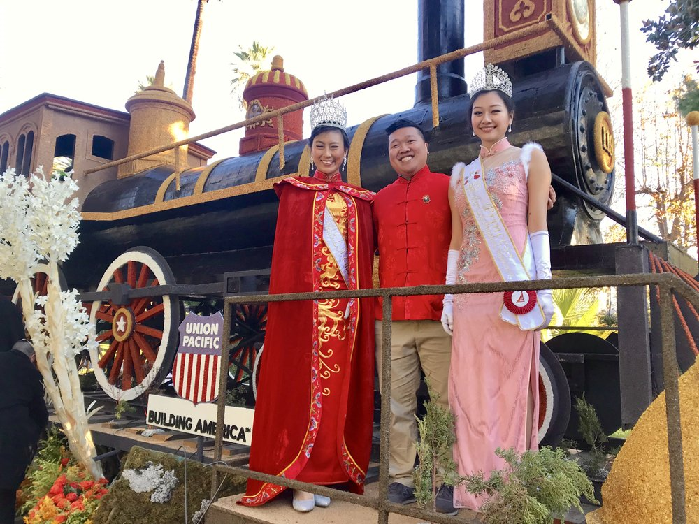 Miss Chinatown, Catherine Liang, stands alongside escort, Macklin Lee, and First Princess, Joyce Lam.