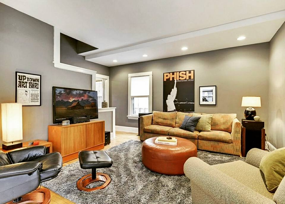 AFTER: Sectional turns into a sofa. 8x10 gray shag rug replaced smaller option. Accent chair joins the party and rounds out the arrangement. Accessories, proper light distribution. Done.