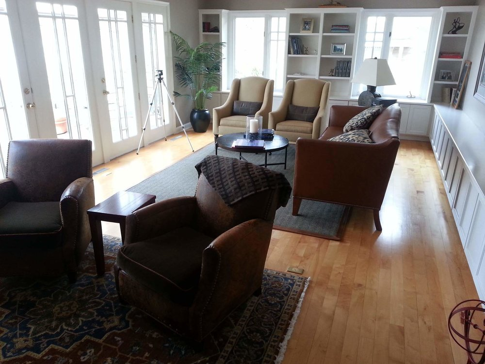 BEFORE: Space is divided in two - gives the illusion of small sitting areas in a larger room - or just small spaces period. Seems like furniture is mad at each other - nobody is talking.