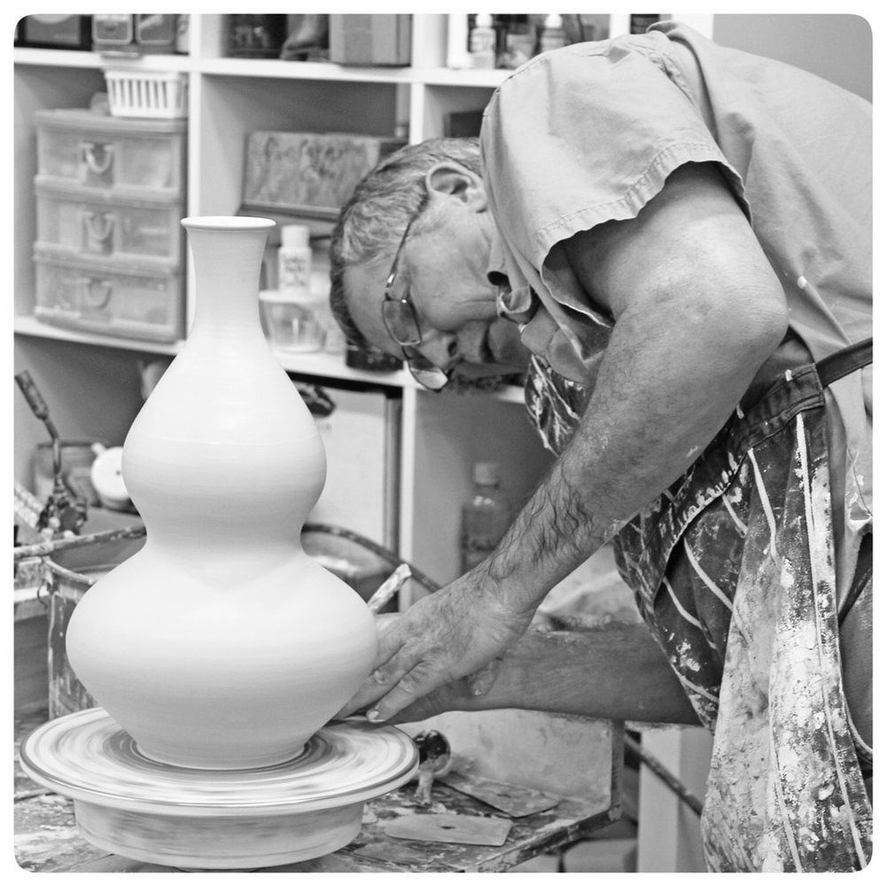 Bruce Gholson working on his gourd vase at his pottery wheel | Bulldog Pottery | Seagrove | North Carolina