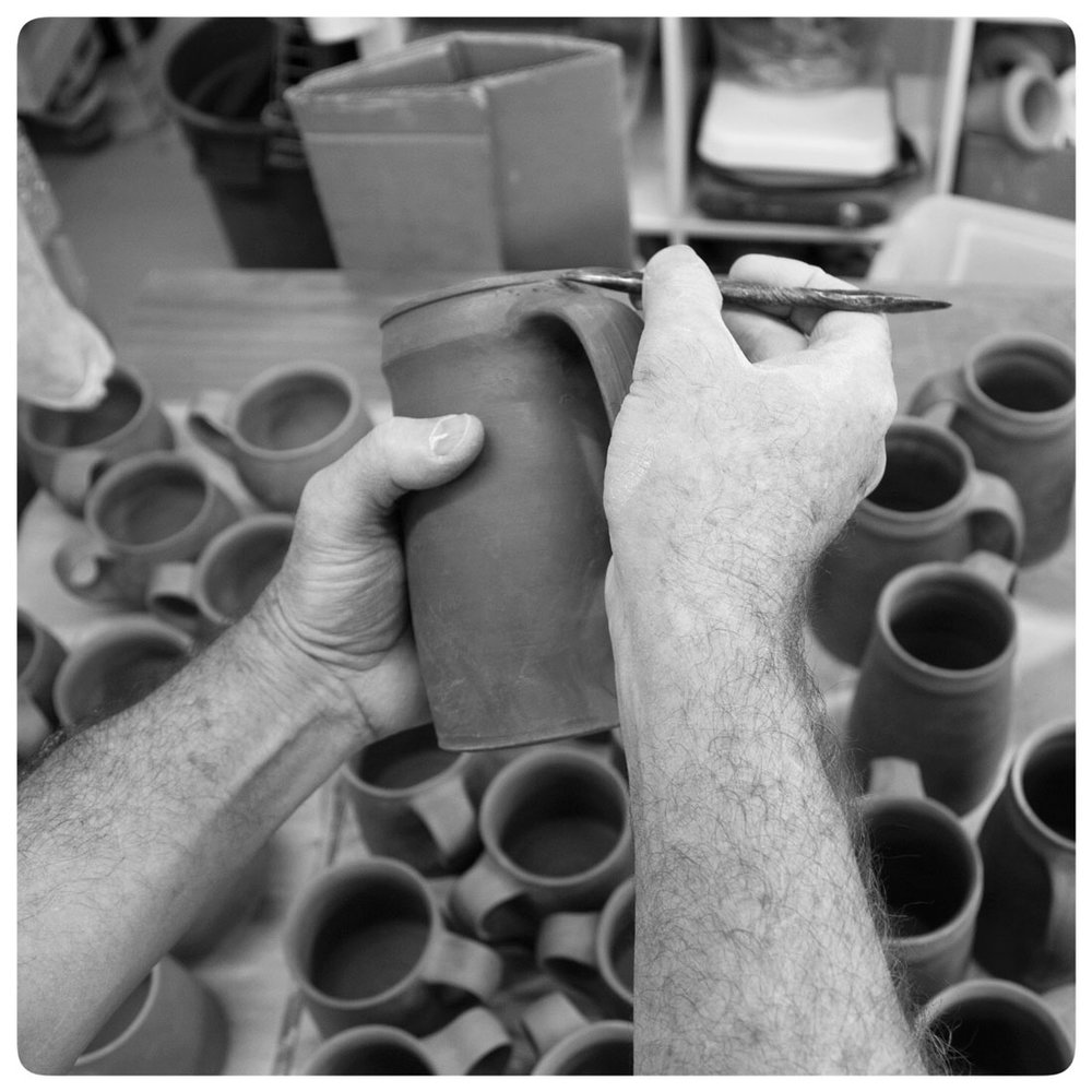 Bruce Gholson putting the finishing touches on his pottery mugs | Bulldog Pottery | Seagrove | North Carolina