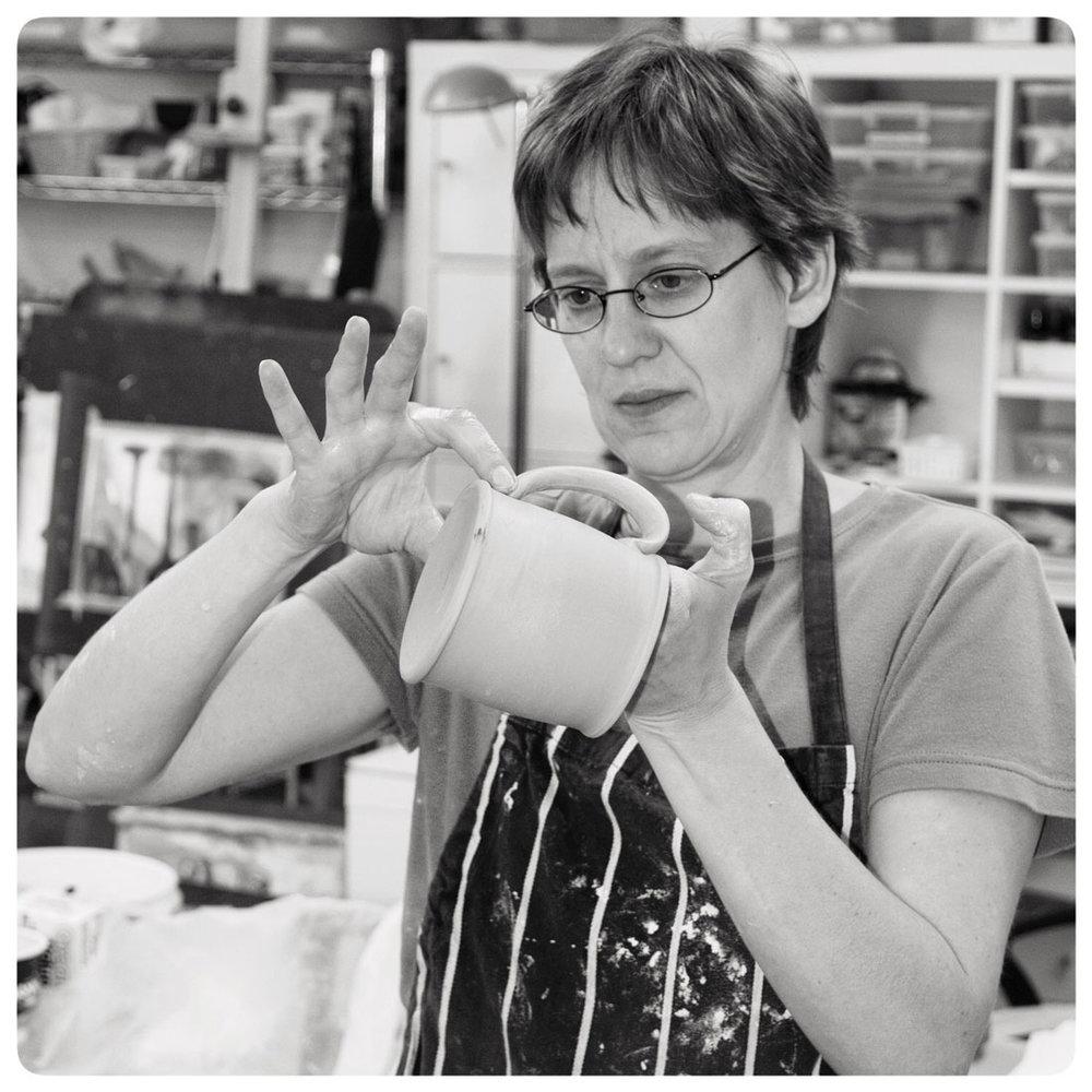 Samantha-Henneke-Working-on-a-Mug-Handle-in-Studio.jpg