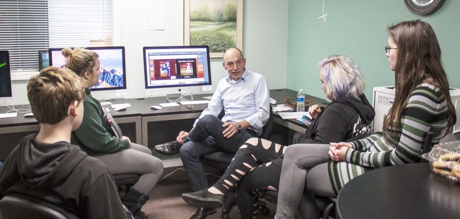 Graphic designer Rinck Heule, center, talks to students at the Belding Success Virtual Learning Center on Thursday about the new graphic design course he will be teaching at the center. The hope is that the class will be able to start as soon as next week. — Daily News/Emilee Nielsen