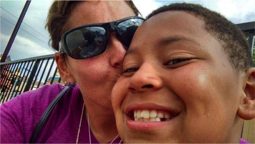 Joanna Wohlfert with her son Michael Martin. Martin, 13, an eighth grader at Everett New Tech High School, died by suicide Jan. 25.   (Photo: Photo courtesy of Joanna Wohlfert)