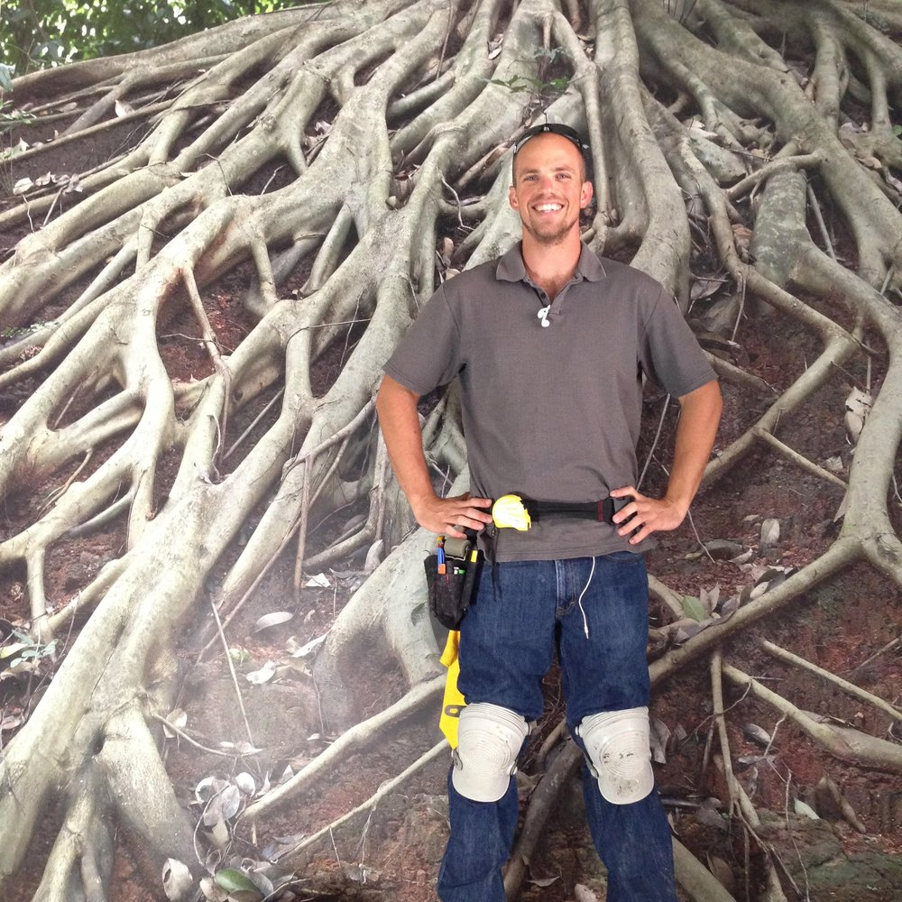 Matt Lyons in front of a completed photo mural installation in downtown San Diego.