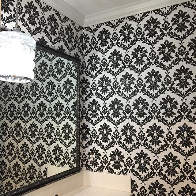 One of this week's completed wallpaper installs. Made for a dramatic before and after! #sandiegointeriordesign #wallpaperdecor #powderroom