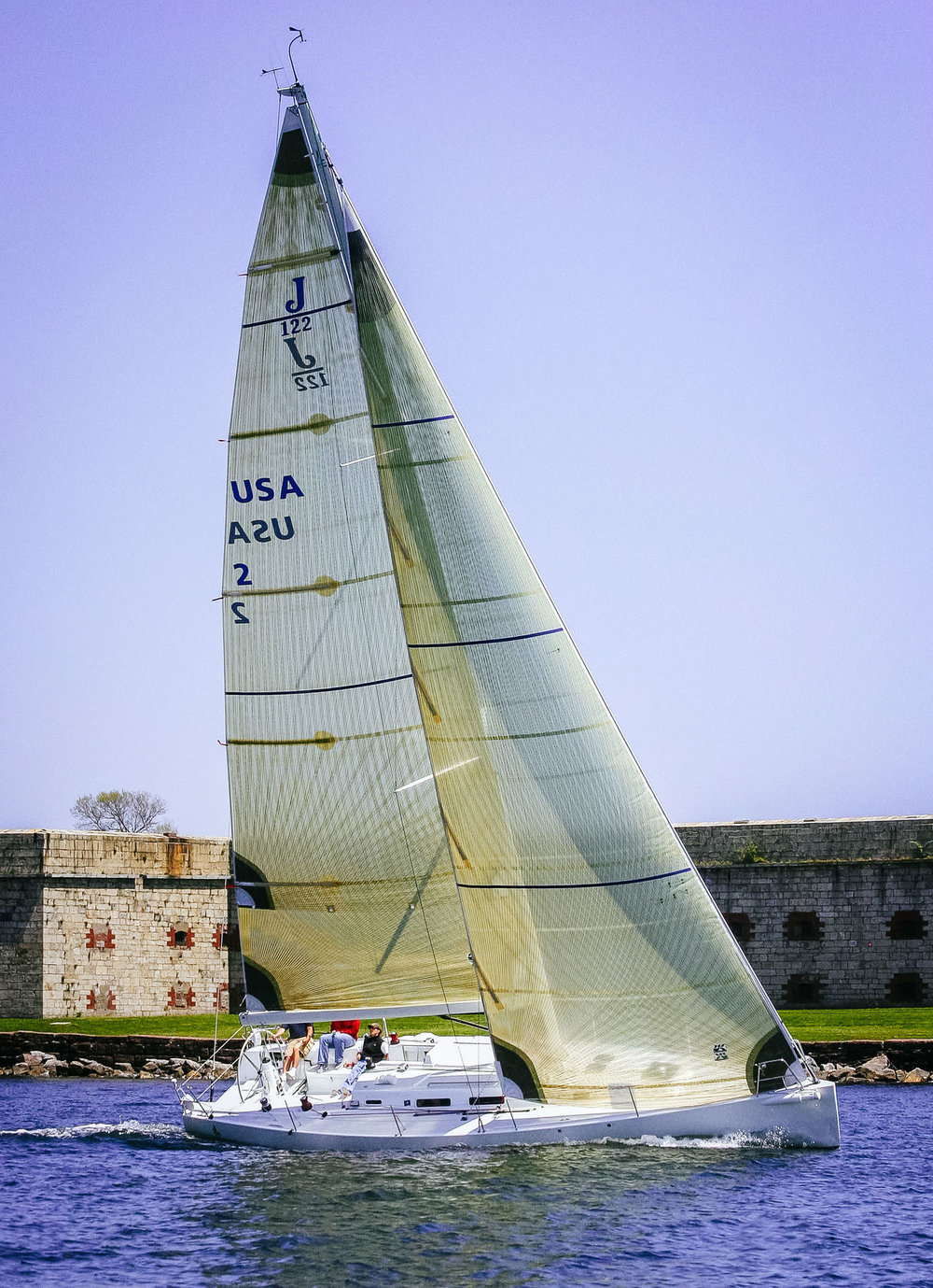With wide swept-back spreaders, the jibs can overlap the mast slightly as shown above on this J/122.