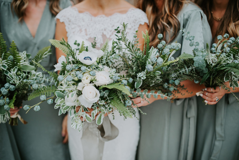 greenery bouquets with ribbons by rose moss designs
