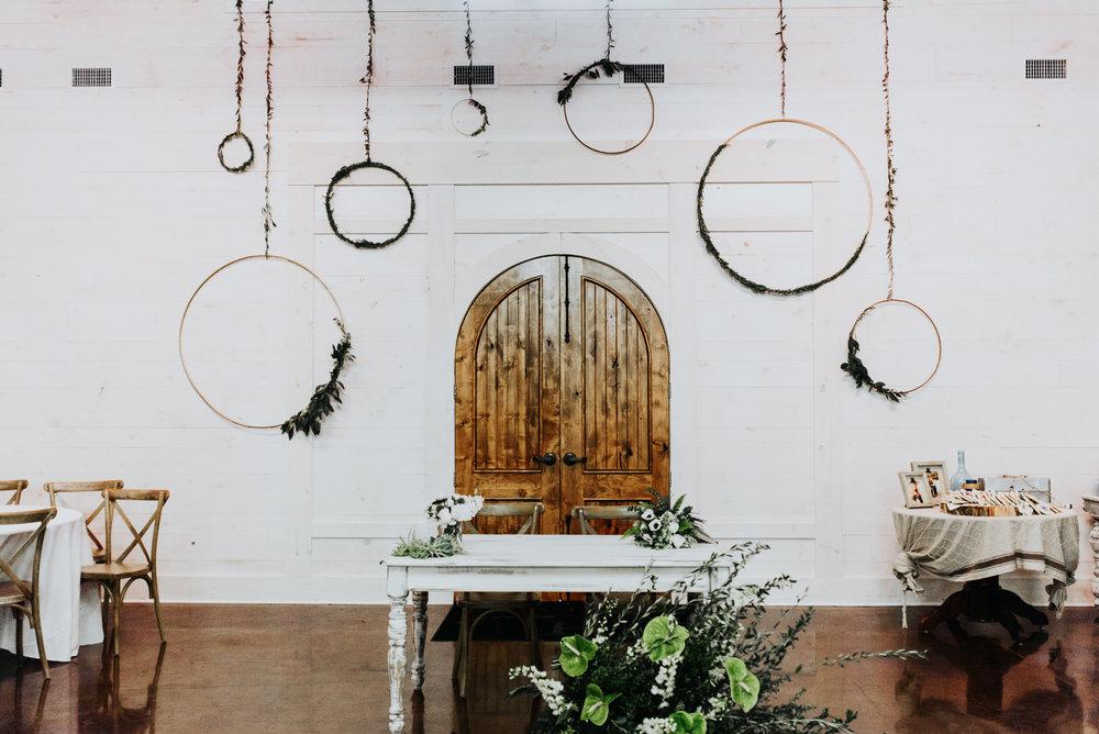 hanging metal hoops wreaths wedding decoration rose moss designs