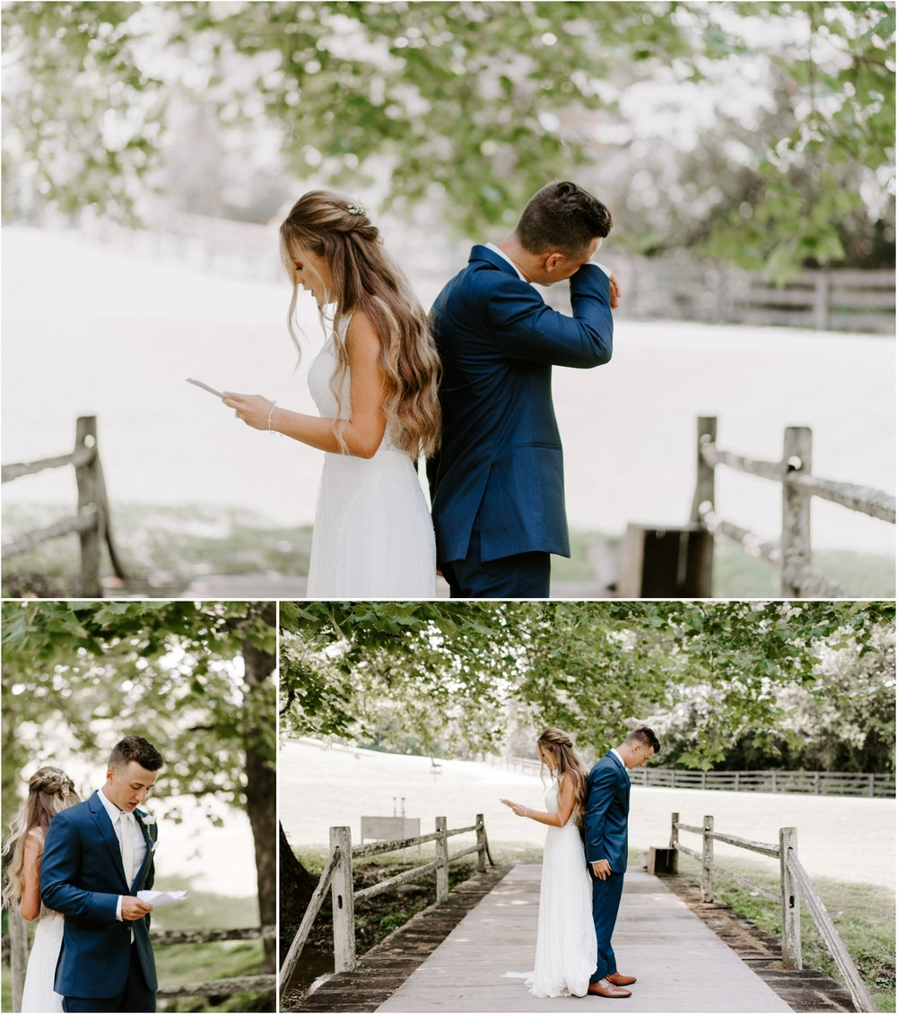 groom crying during first look reading letters to each other