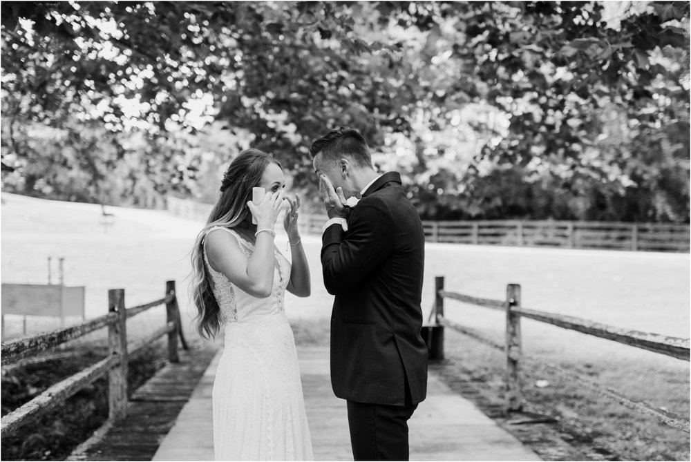 black and white bride and groom crying during first look
