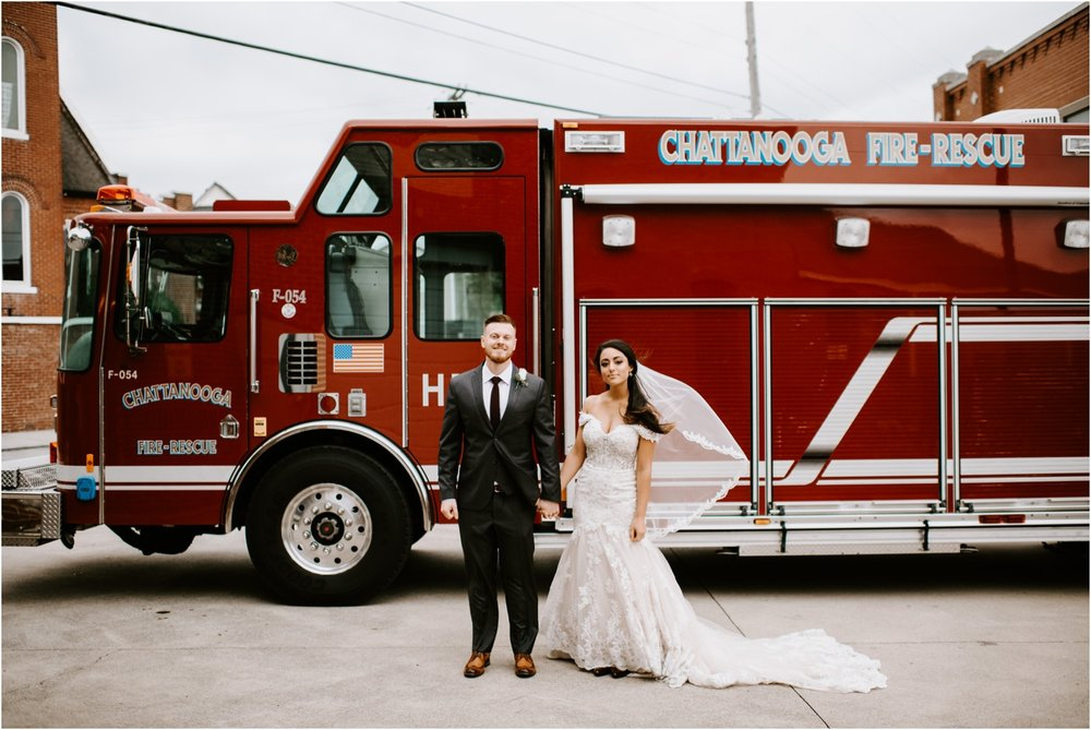 bride and groom portrait in front of fire truck