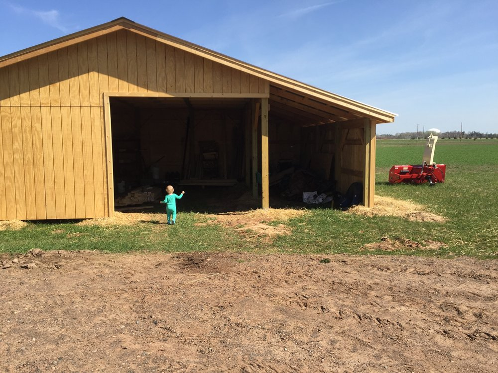 The kiddo explores the newly finished machine shed
