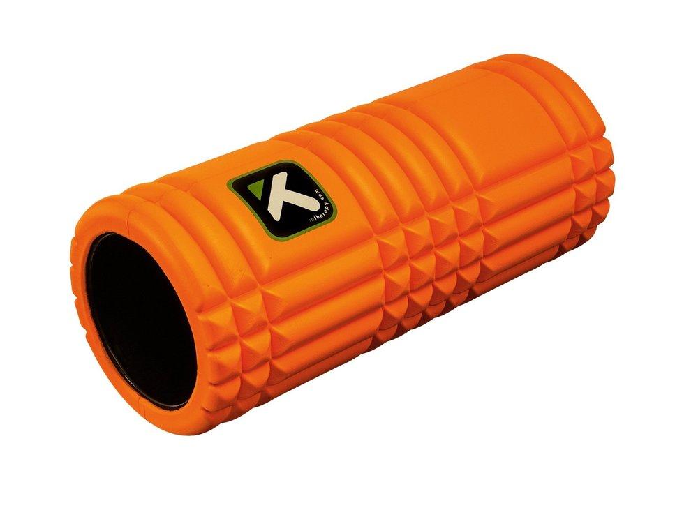 An orange foam roller.