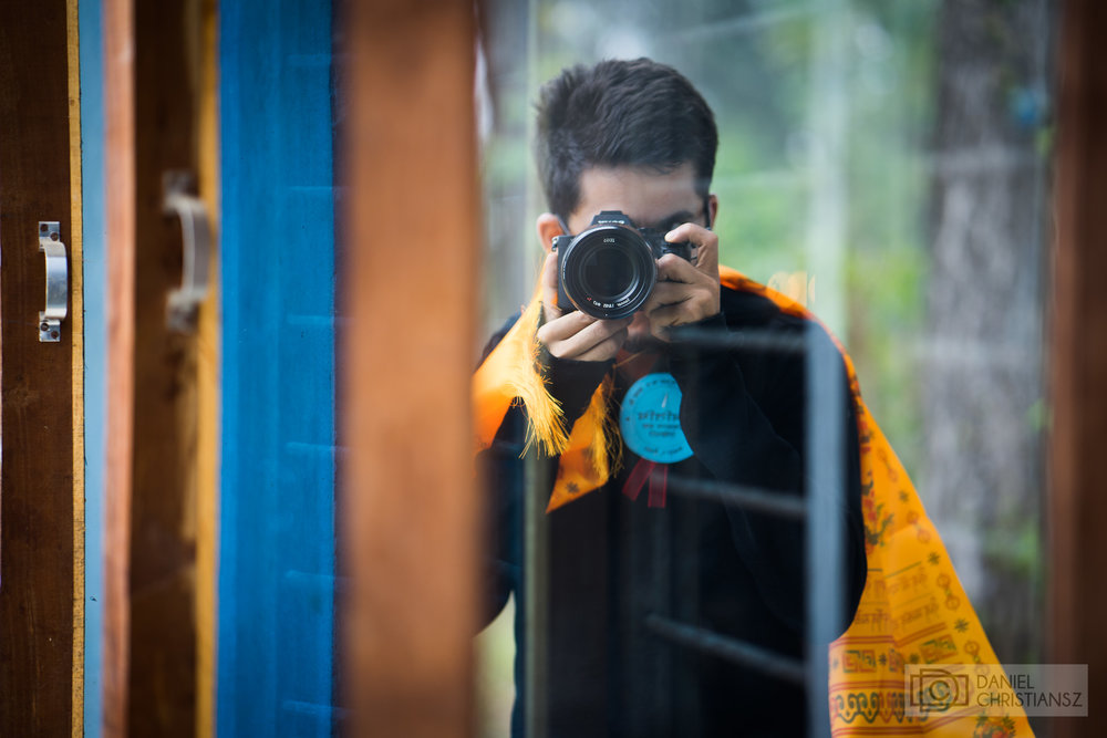 Man with Camera in Mirror