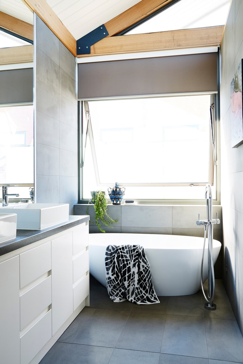 Try a contemporary design with hand-less drawers and a statement bath to die for.