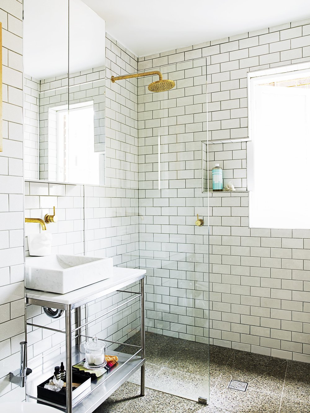 These brass fixtures make a fantastic statement against the modern tiles!