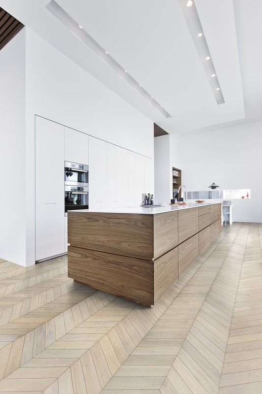 Chevron parquet can make a narrow space look wider!