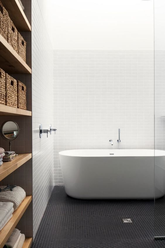 These simple and elegant geometric tiles give this bathroom that edge.