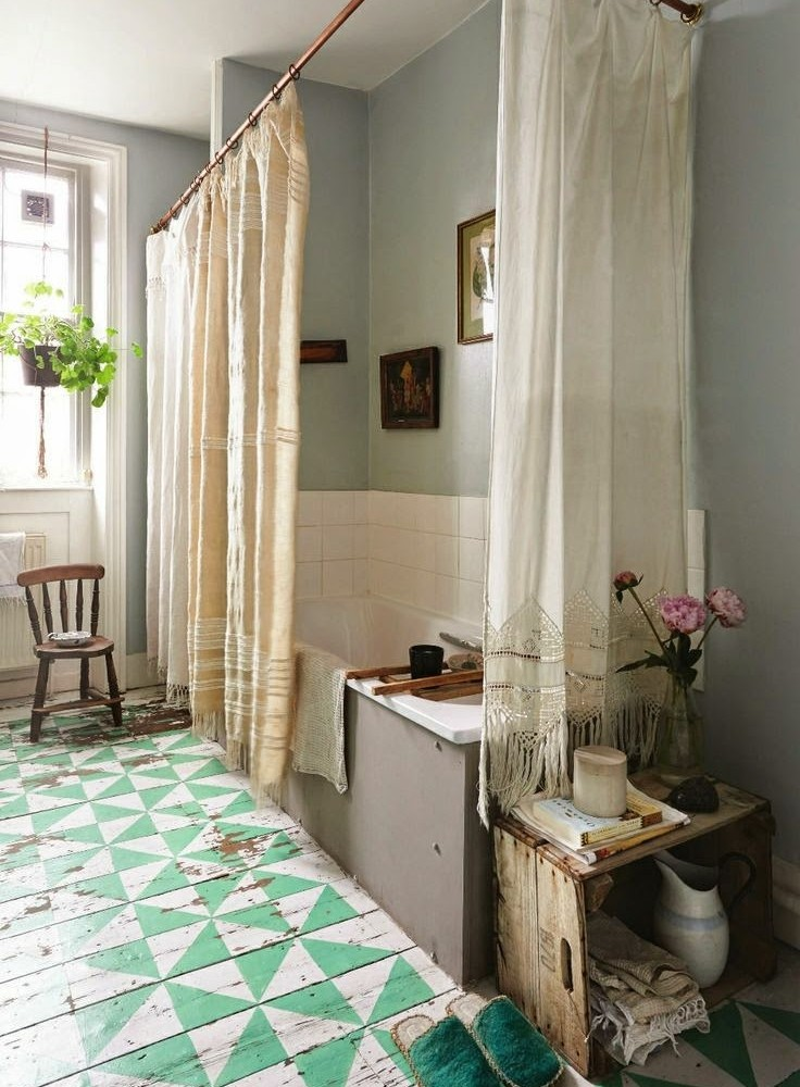 For that shabby chic look go for painted floor boards which will age with time and will give the bathroom a real unique look.