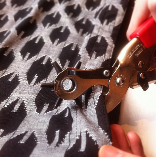 Purse, meet rotary hole punch. Rivets, coming up. Getting ready to release the new Fair Trade Handwoven dhaka collection.