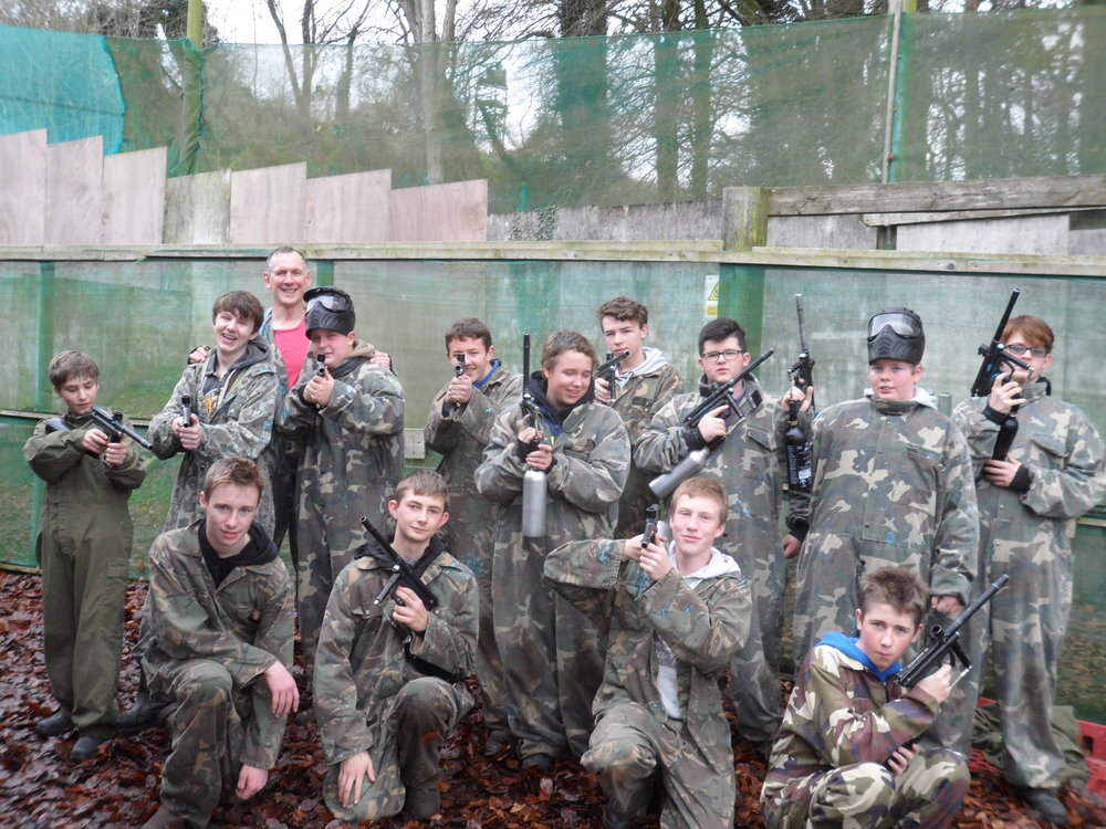 eq   students enjoying a paintball day at the end of a successful school year.