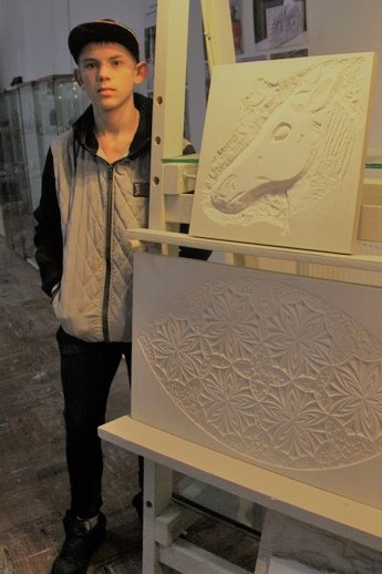 Josh proudly displays his first attempt at stonecarving. It's of a horse that he has been working with at the local stables that he attends.  A second commission is expected during 2018 which will be placed in the wall of the new stables at Portland Bill where it will become a permanent feature.