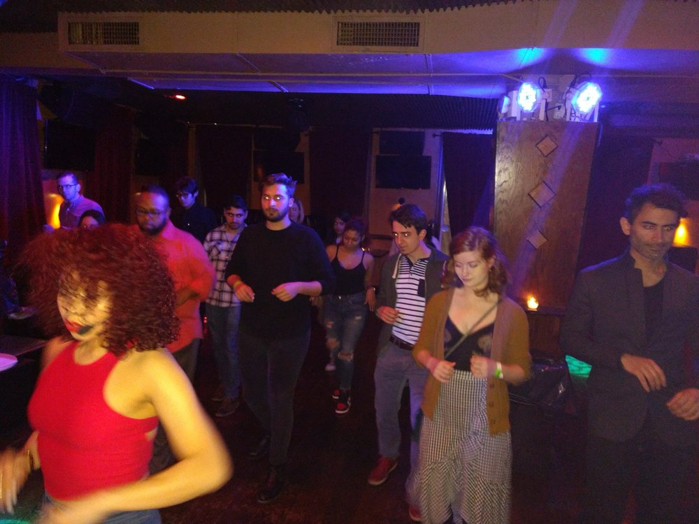 Outpost Club members learning how to salsa!