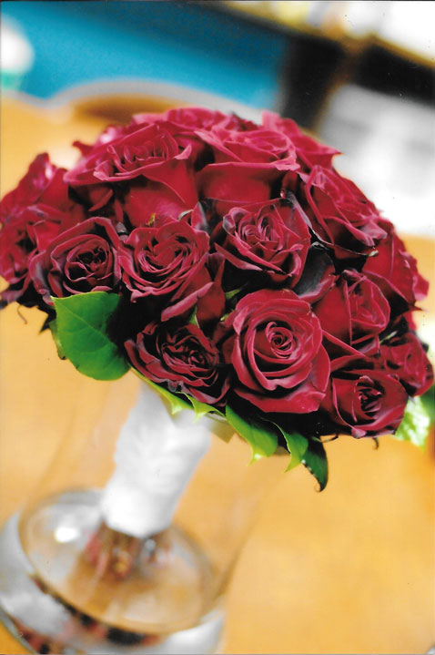 A classic bouquet of long stem red roses