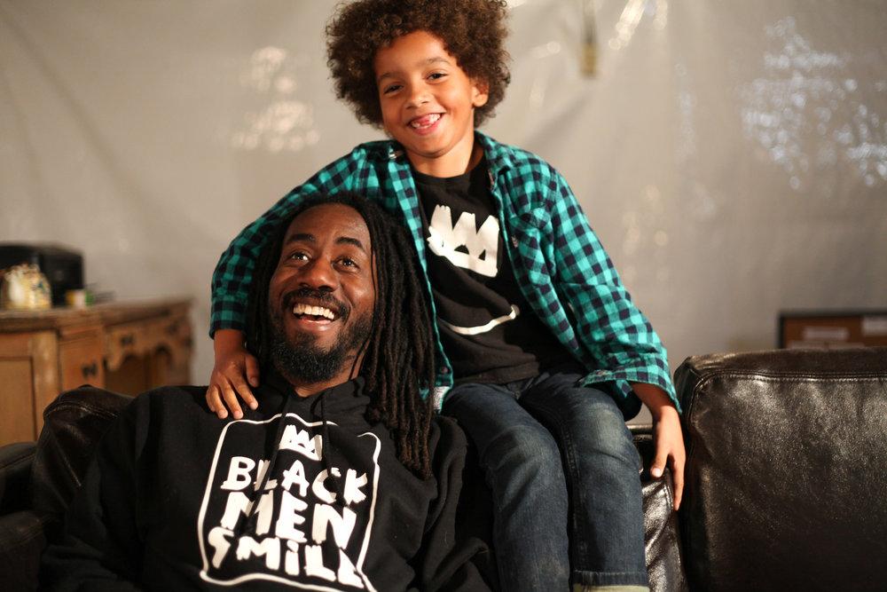 Black Men Smile® Creator, Carlton Mackey with his son Isaiah.