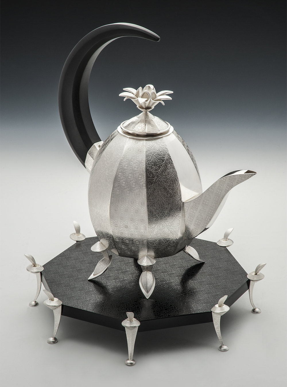 Slippers Teapot  |  2000  |  sterling silver, maple, micarta  |  13 x 10 x 10 inches
