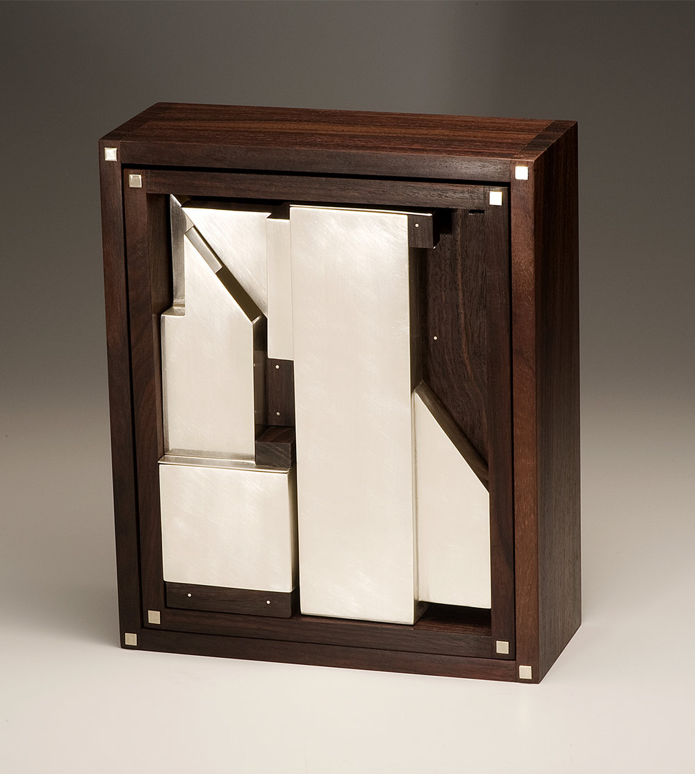 Puzzle Teaset-closed  |  2010  |  sterling silver, rosewood  |  10.25 x 8.5 x 3.33 inches