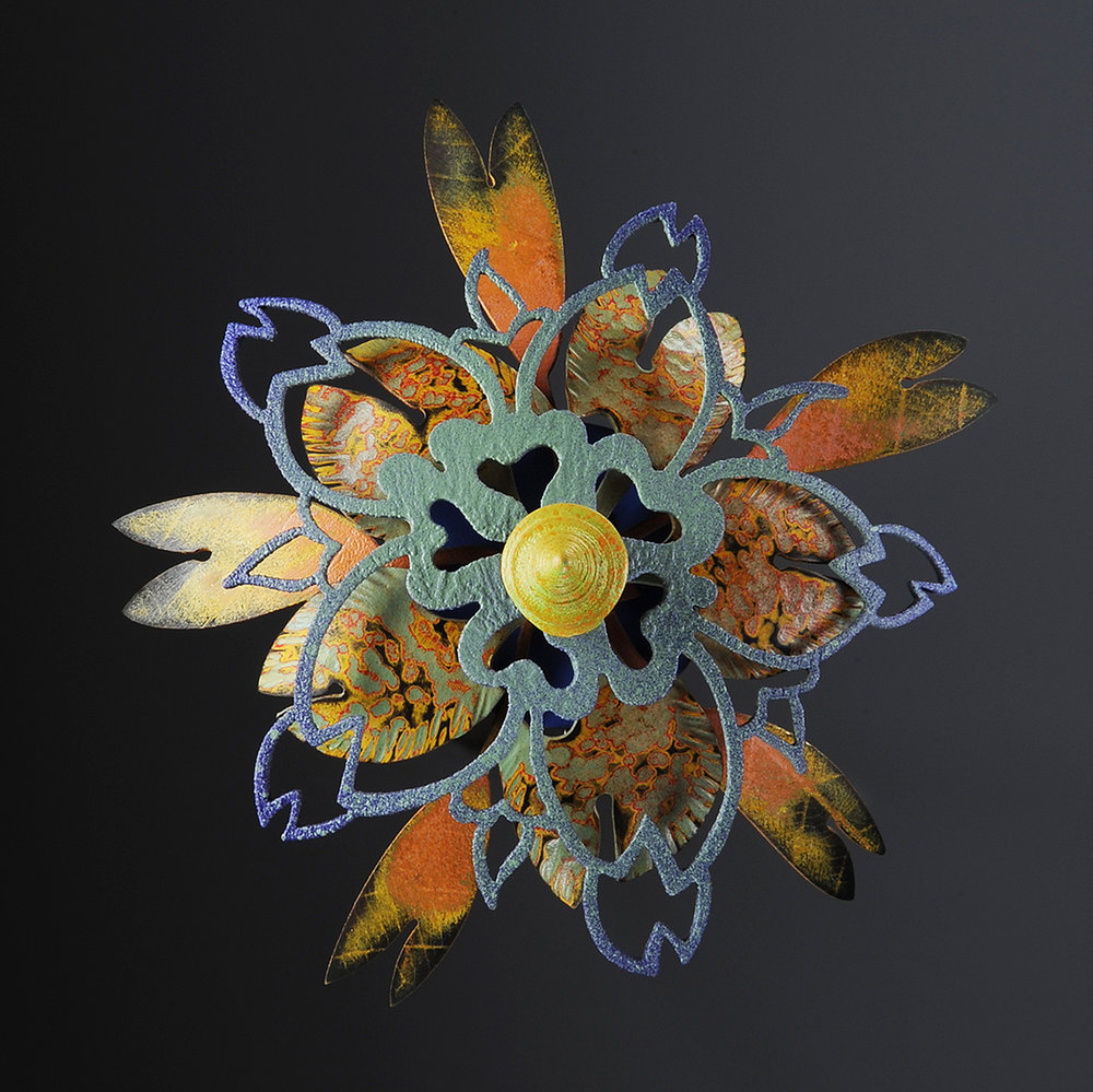 Rosette Brooch 2-11  |  2011  |  copper, brass, polymer  |  4.5 x 4.5 x 1.5 inches
