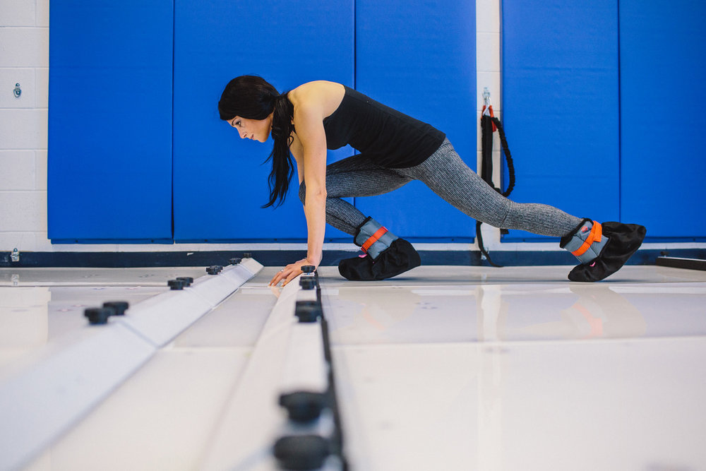 Carla performing mountain climbers at our NSIA studio. Ankle weights optional.