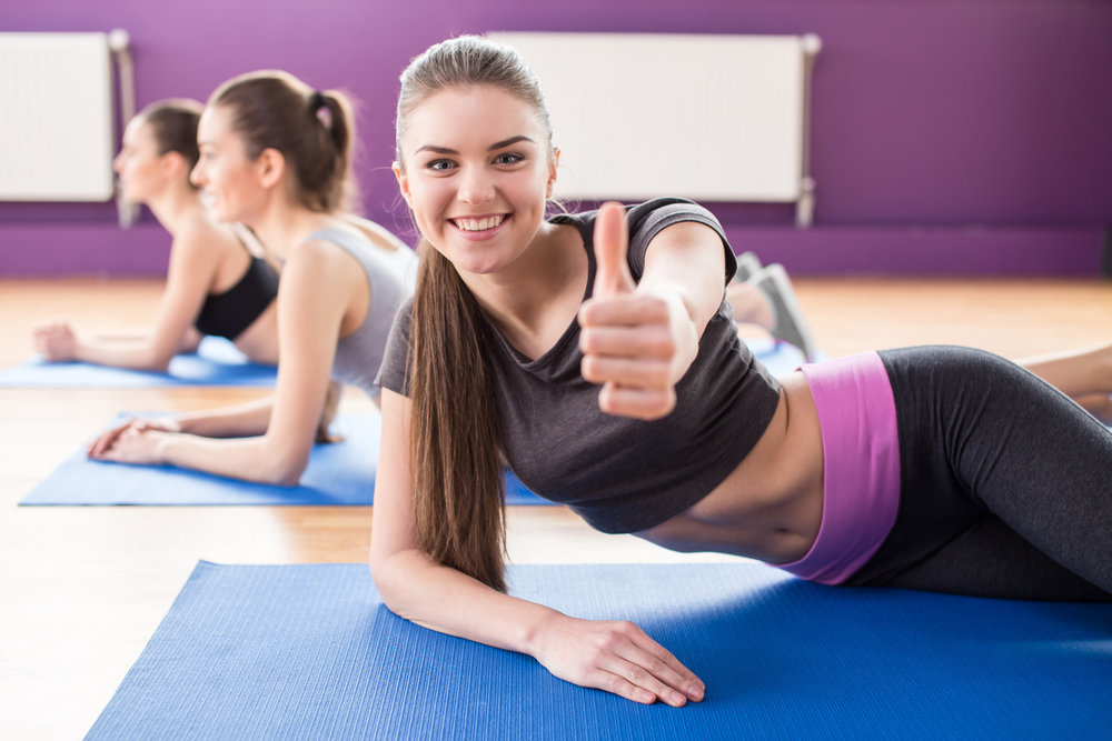 Girl_In_Gym_Fotosearch_k23905848.jpg